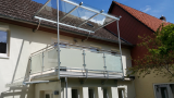 Balkon mit Glasdach